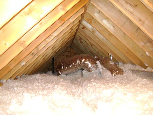 Attic space with both fiberglass batts and blown in loose fill.